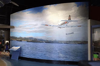 This museum sets the scene of their exhibit with a custom wall wrap