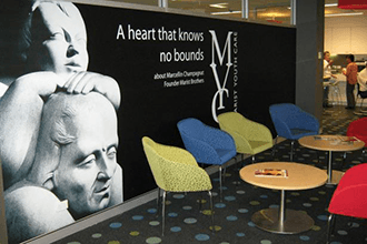 Reception area graphic incorporating the company motto with images