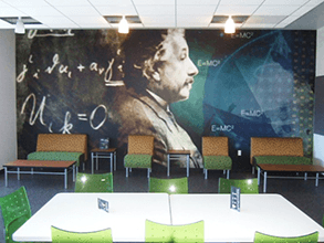 This commemorative wall mural centers this conference room