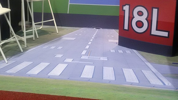 Dye-sub carpet for an airport's exhibit booth featuring a photo of their runway.