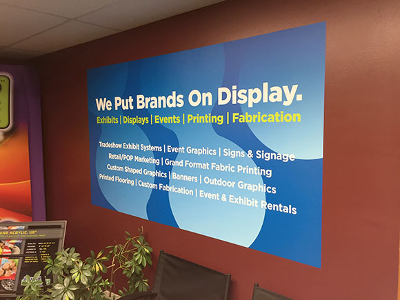 Adhesive branding message wall graphic in the Beautiful Displays lobby